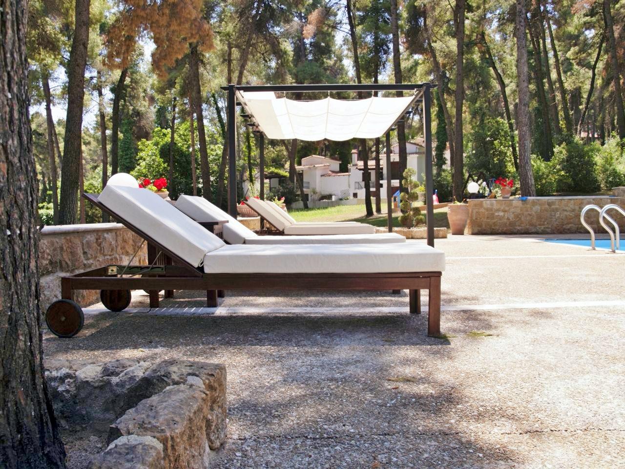 Sani Cape Villas Shared Pool Sunbeds